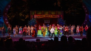 Andy Christopher (center) and cast Photo: The Muny